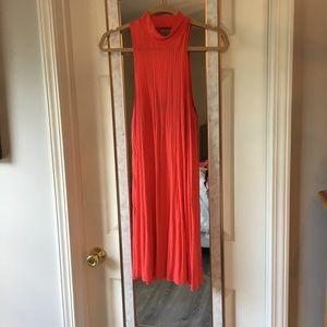 Hot orange dress, open back, high neck